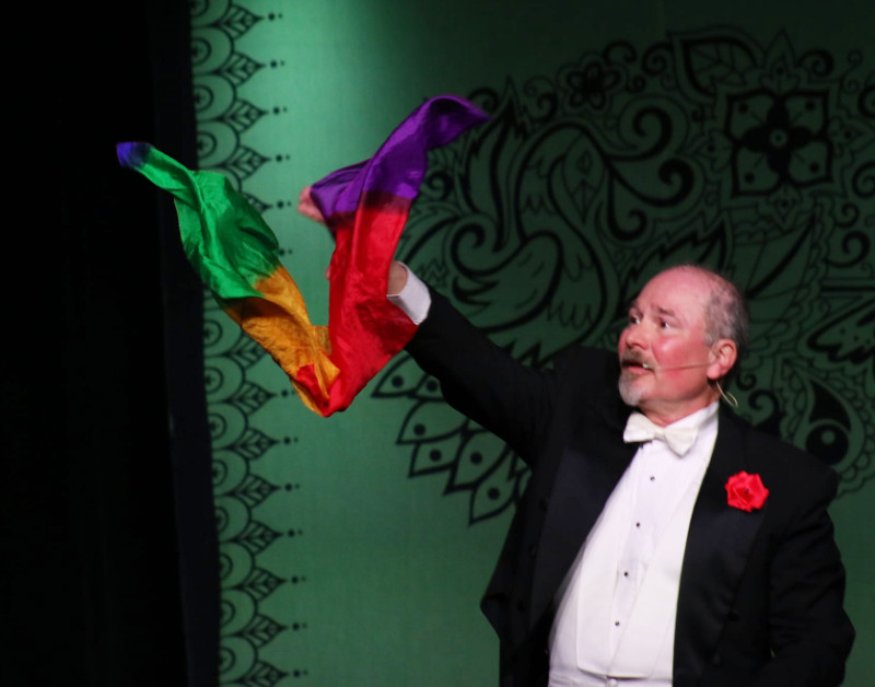 Magician Daryl Rogers Performs a Silk Trick